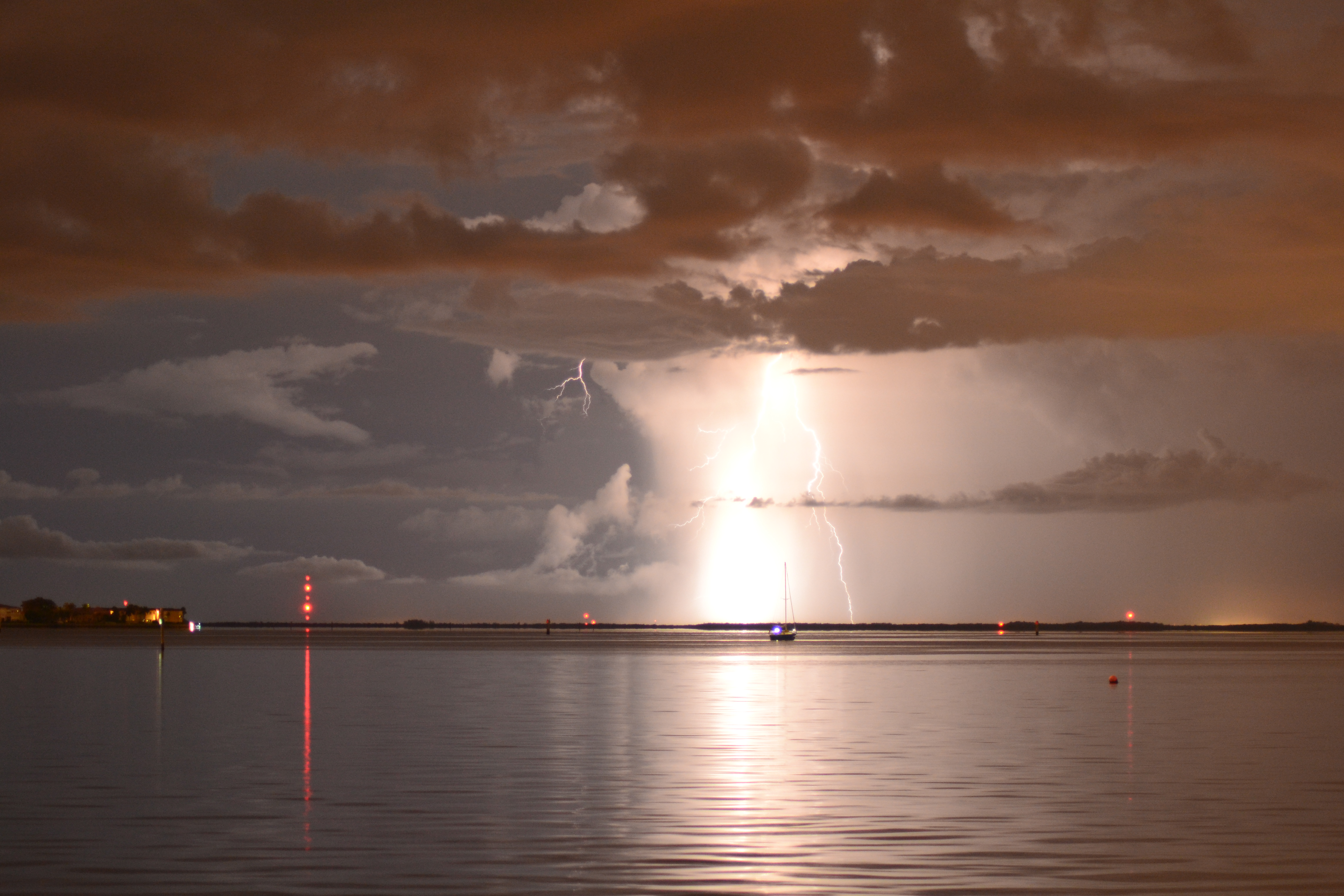 Lighting Strikes Over Calm Water artwork by Jasmin Pawlowicz - art listed for sale on Artplode